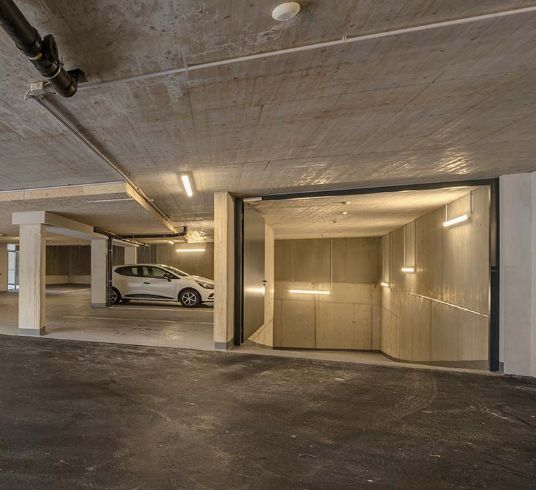 Modern, large underground car park with e-charging station - St. Anton, Arlberg
